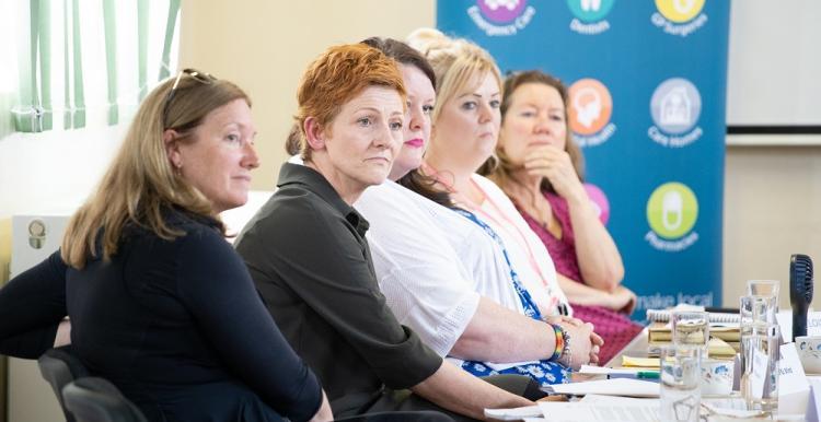 Five women panellists sitting in a row