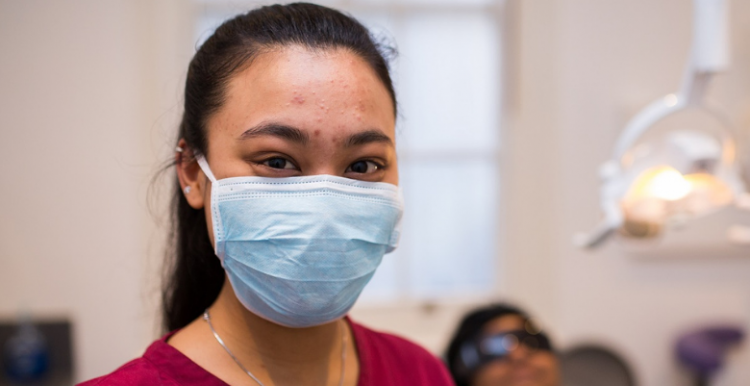 Dentist in mask looking at camera