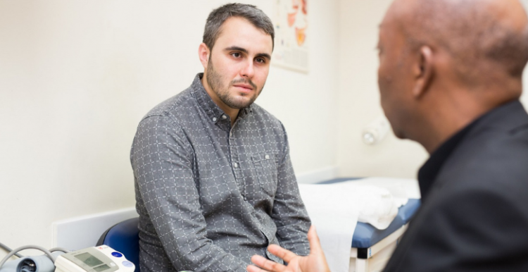 Male patient talking with a GP