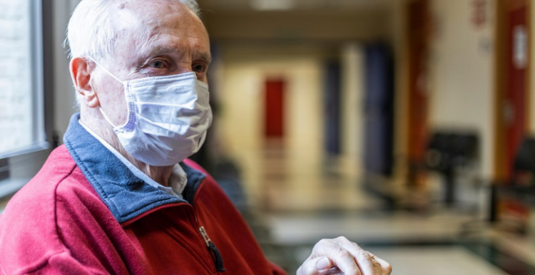 man wearing a face covering in hospital