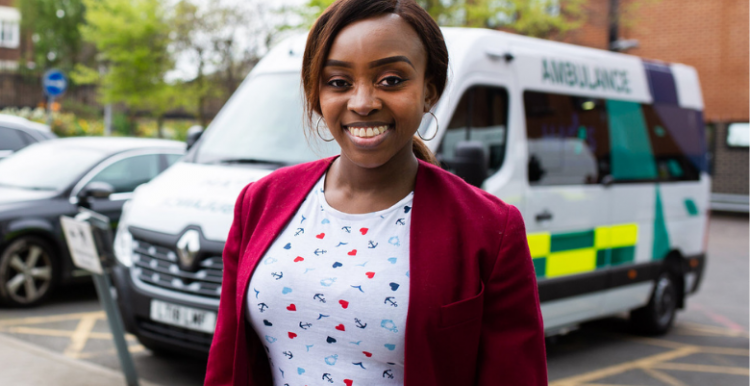 woman with an ambulance in the background