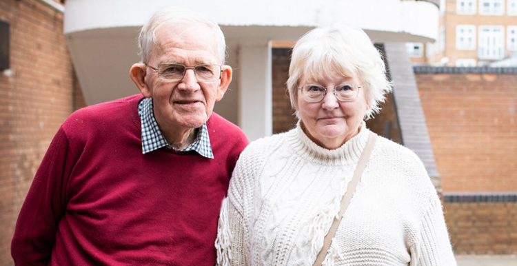 Picture taken at a healthwatch event shows older man and woman looking at the camera
