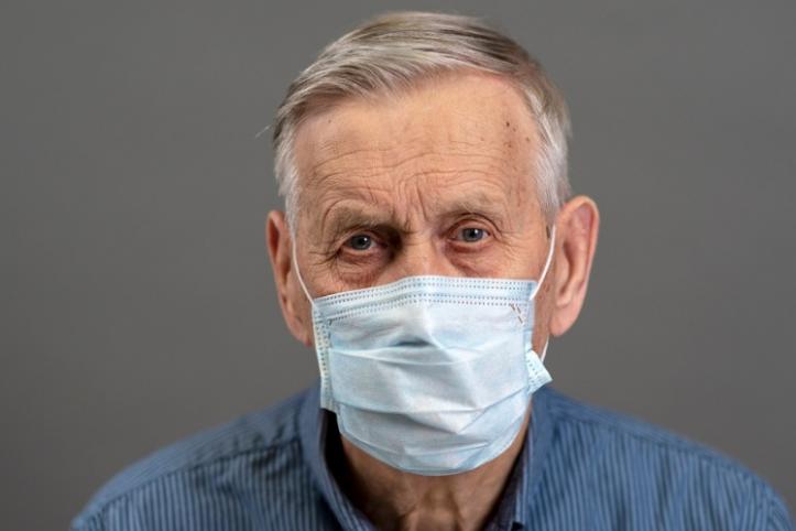 older man wearing a mask