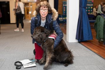 Woman with sensory dog at Healthwatch event