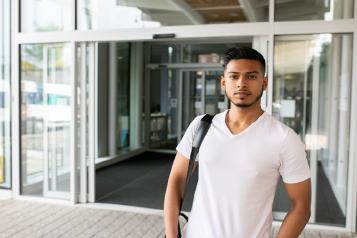 young man outside hospital