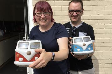 young couple pictured with camper van garden planters
