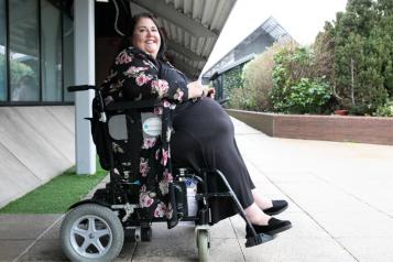 woman in power wheelchair