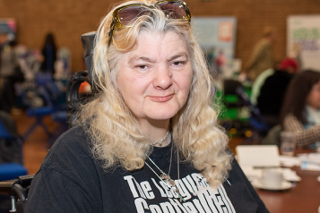 Picture shows woman at Healthwatch event wearing a League of Gentlemen top