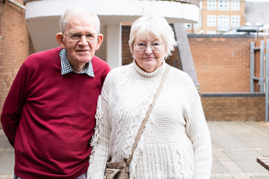Older couple in courtyard at Healthwatch event