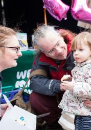 Healthwatch volunteer talking to little girl