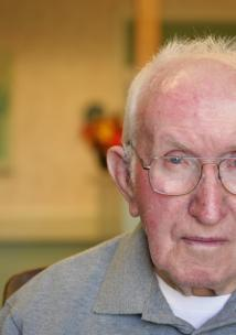 Picture shows older man looking at camera
